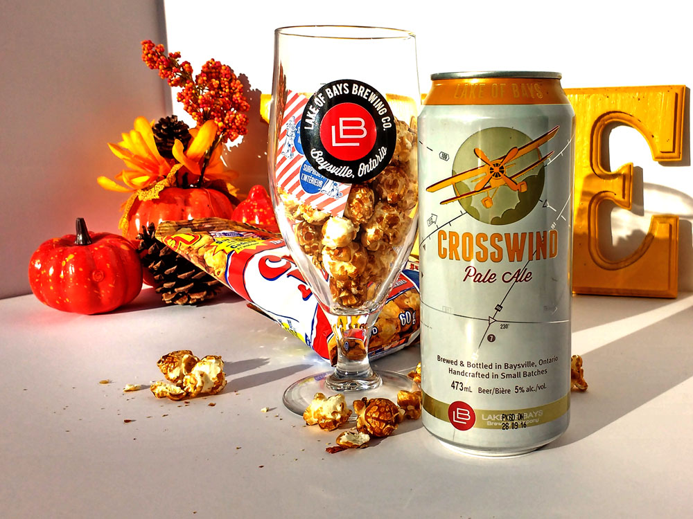 Crosswind Can beside an LB glass filled with Cracker Jacks.