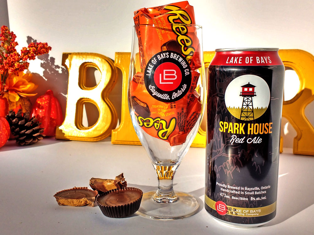 Spark House can beside an LB Glass filled with packages of Reeses peanut butter cups